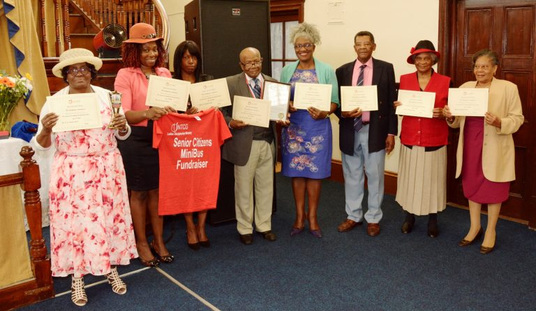 Walkers receiving their certificates of Recognition